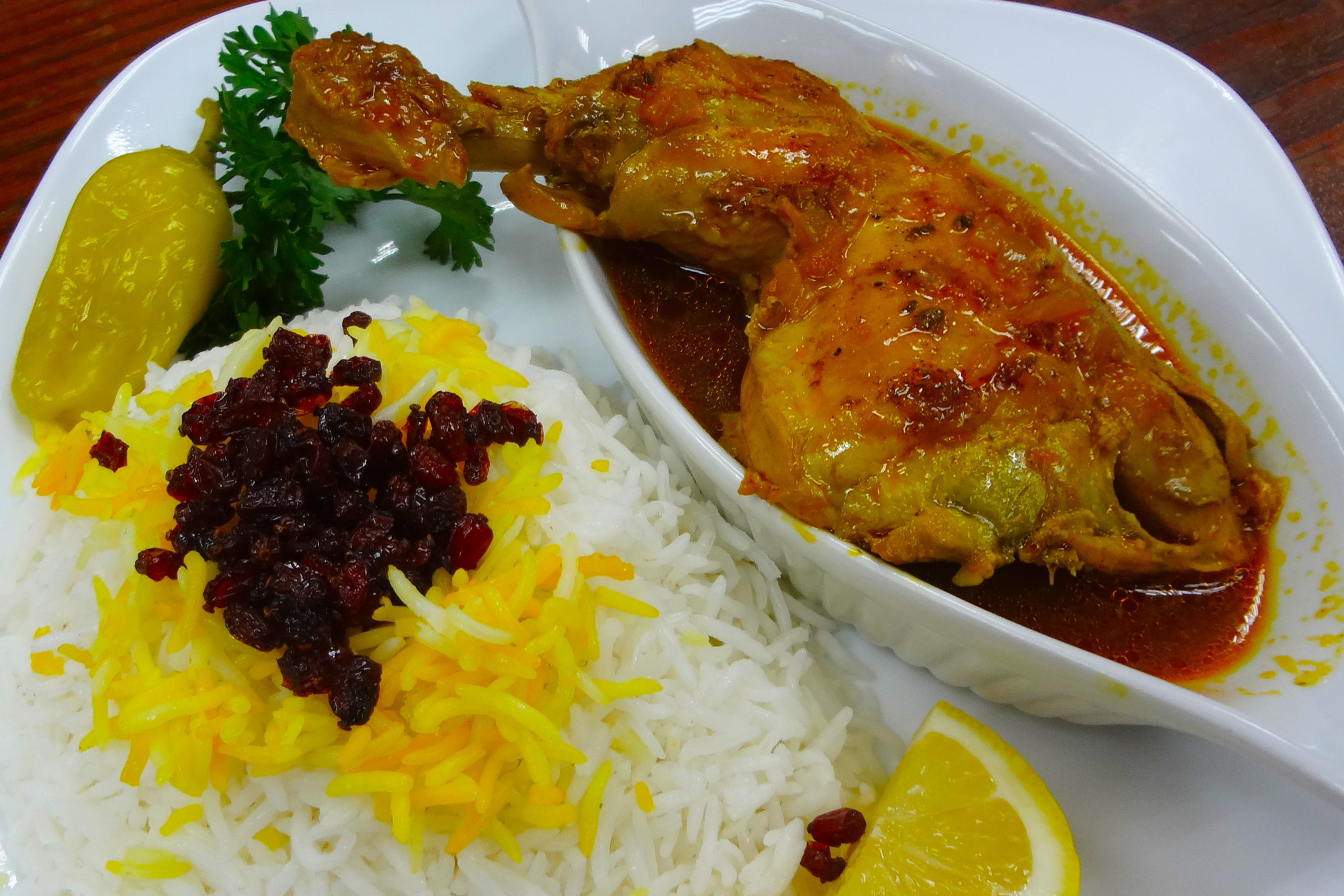 Cholo Morgh with Zereshk is Barberry rice mix served with marinated Chicken Leg at Sahel Persian Restaurant