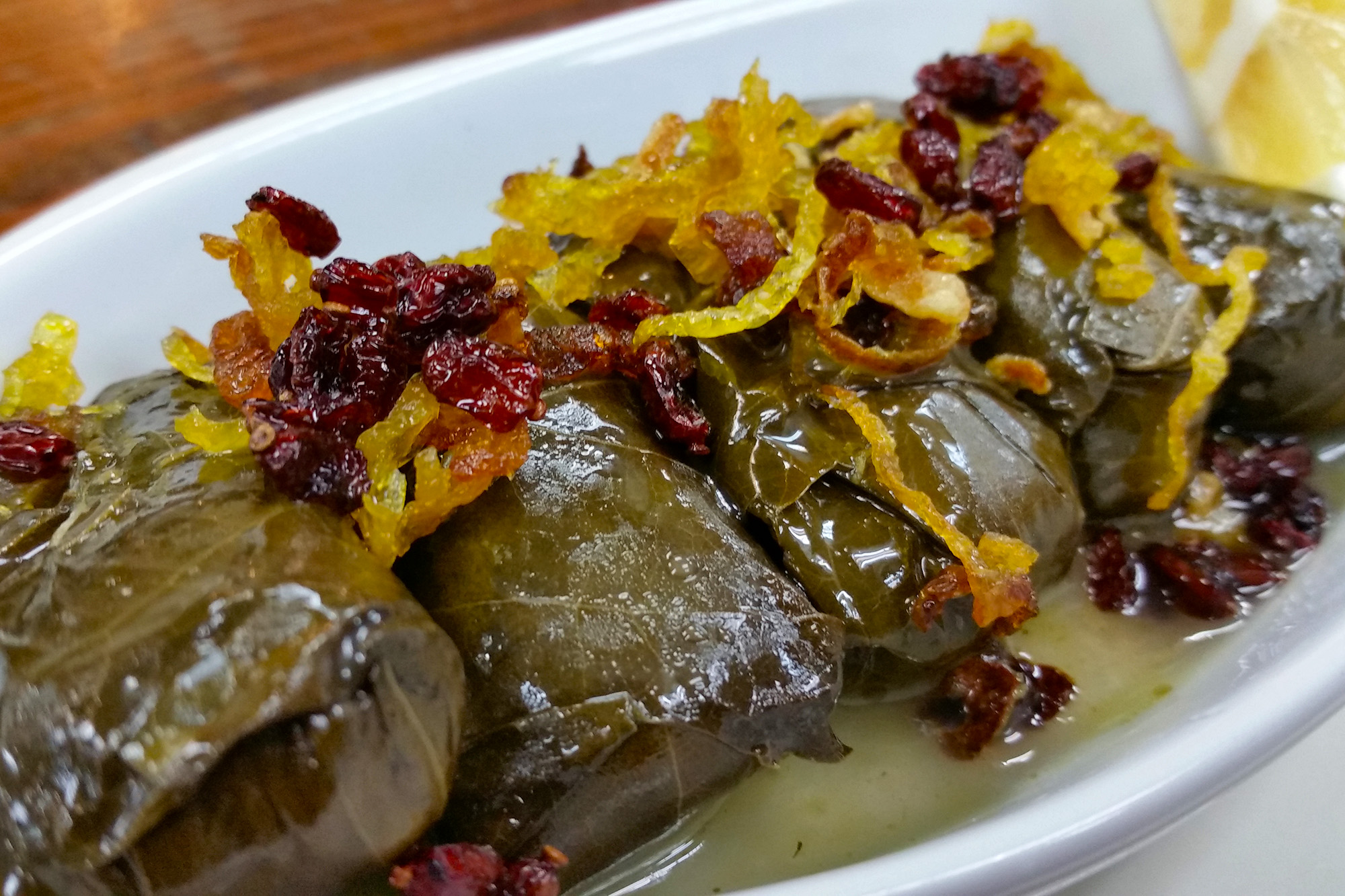 Dolmas ~ stuffed grape leaves topped with fruit at Sahel Persian Restaurant