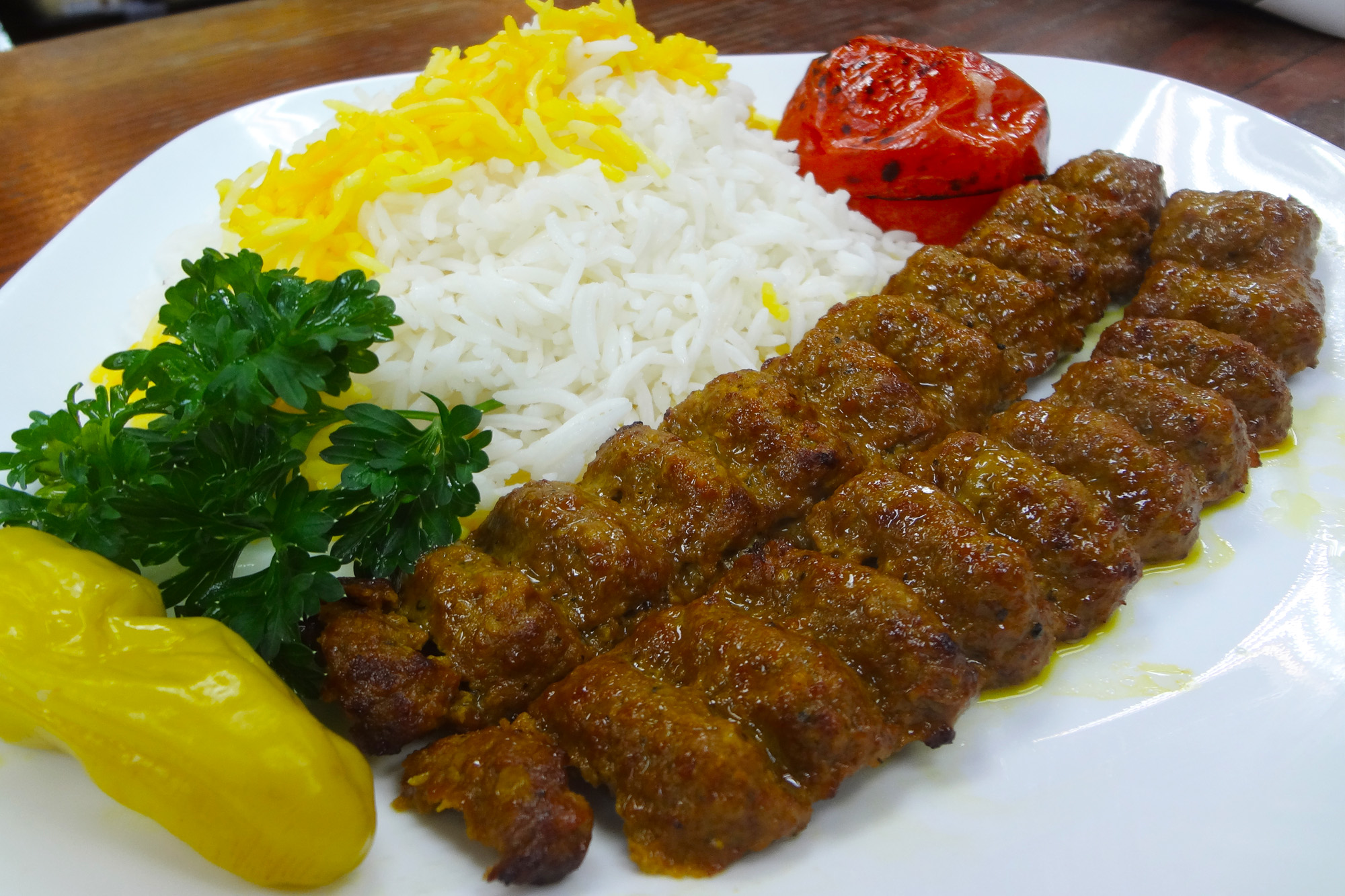 Kubideh Kebab - Two ground beef skewers served with basmati rice and grilled tomatoes at Sahel Persian Restaurant