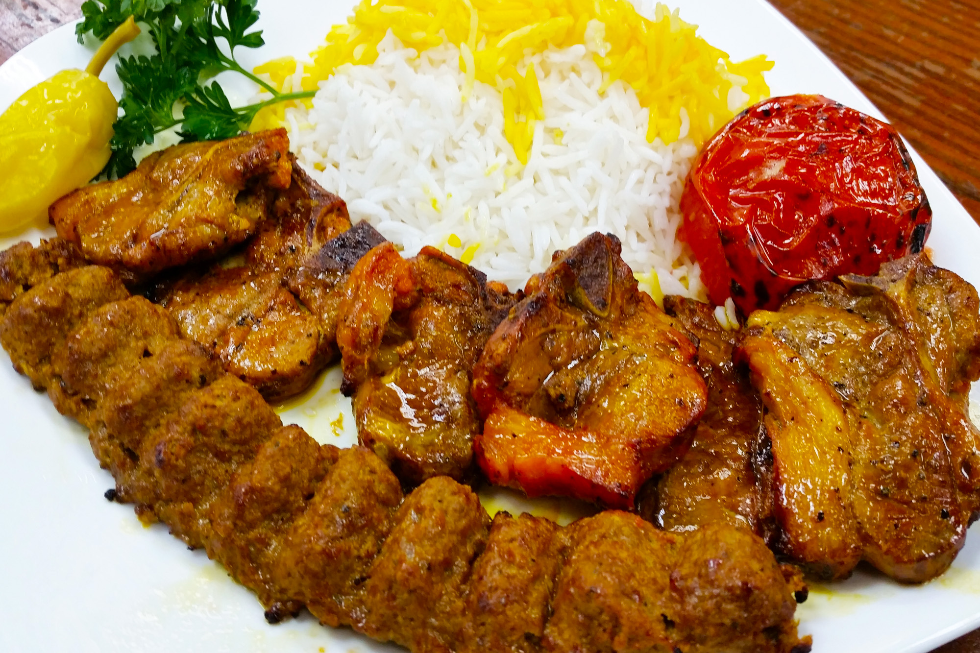 Lamb Soltani = Lamb loin chops and one ground beef skewer with rice at Sahel Persian Restaurant