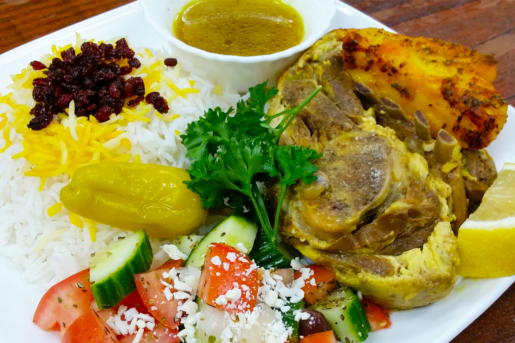 Roast Lamb = Lamb shoulder with Greek salad and potatoes at Sahel Persian Restaurant