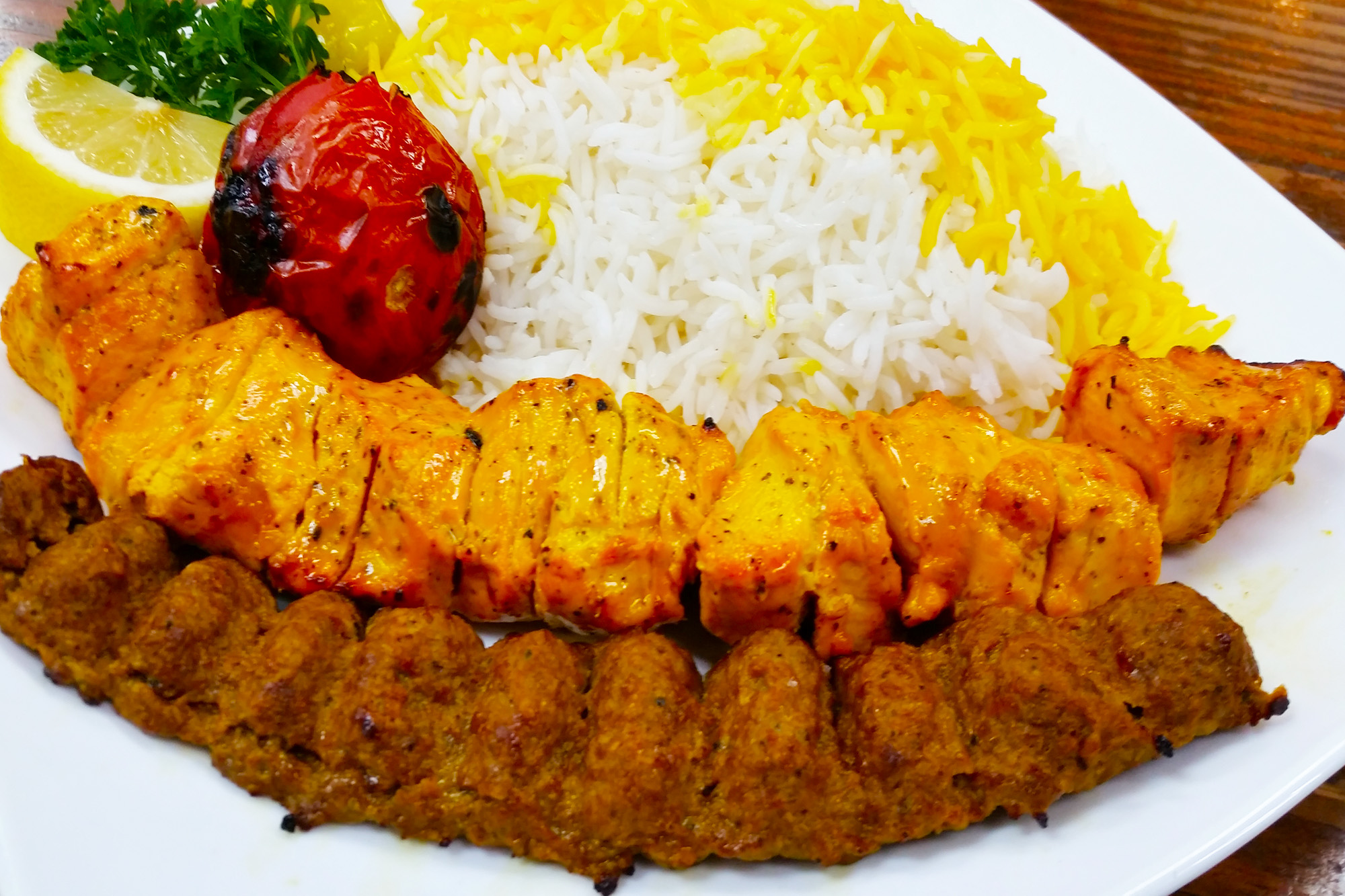 Vaziri Kebab = One skewer of chicken and one skewer of ground beef served with basmati rice and grilled tomatoes at Sahel Persian Restaurant
